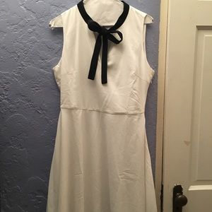 White skater dress with black tie front